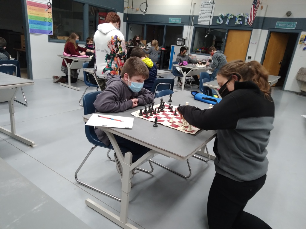 Mrs. Stevens works with students in Chess Club at the Parkside A+ After School Program.