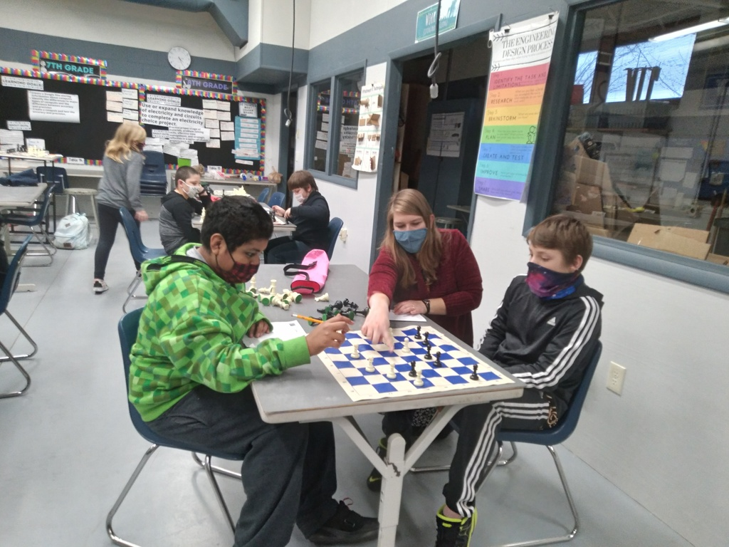 Ms. Albrecht helps students learn chess notation at the Parkside A+ After School Program.