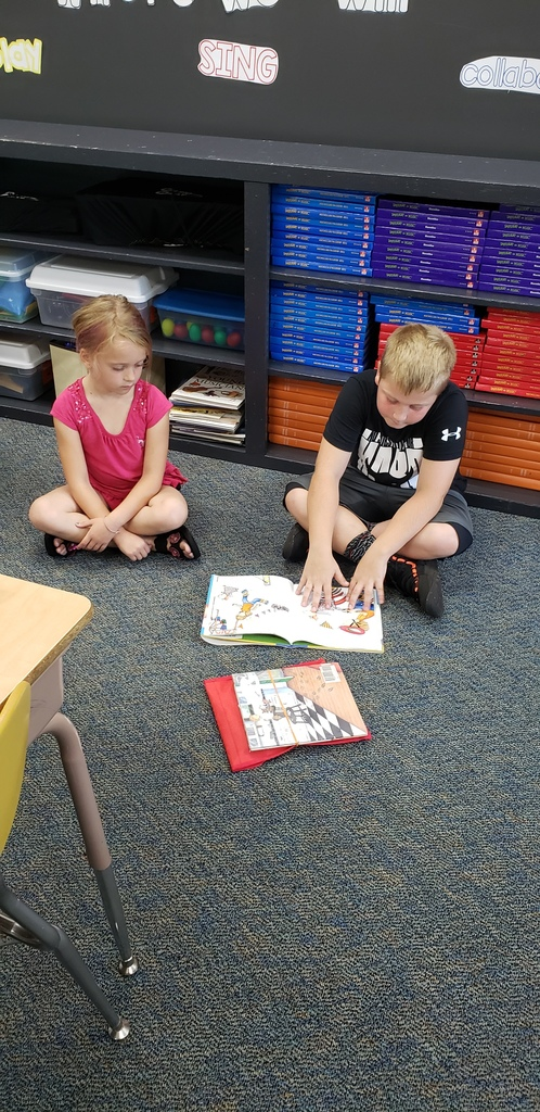 Reading buddies at Redgranite A+. 4th & 5th graders are paired with 1st graders!