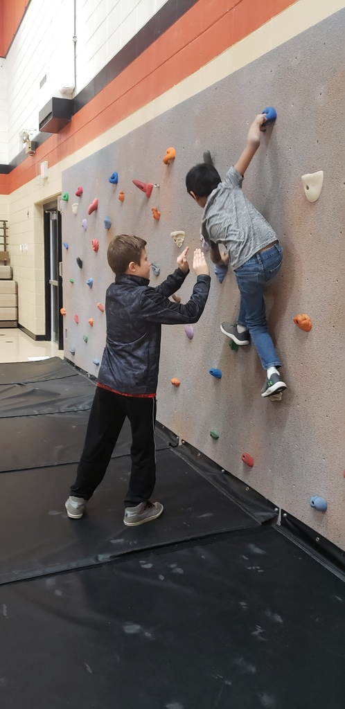 Students practicing on the traverse wall.